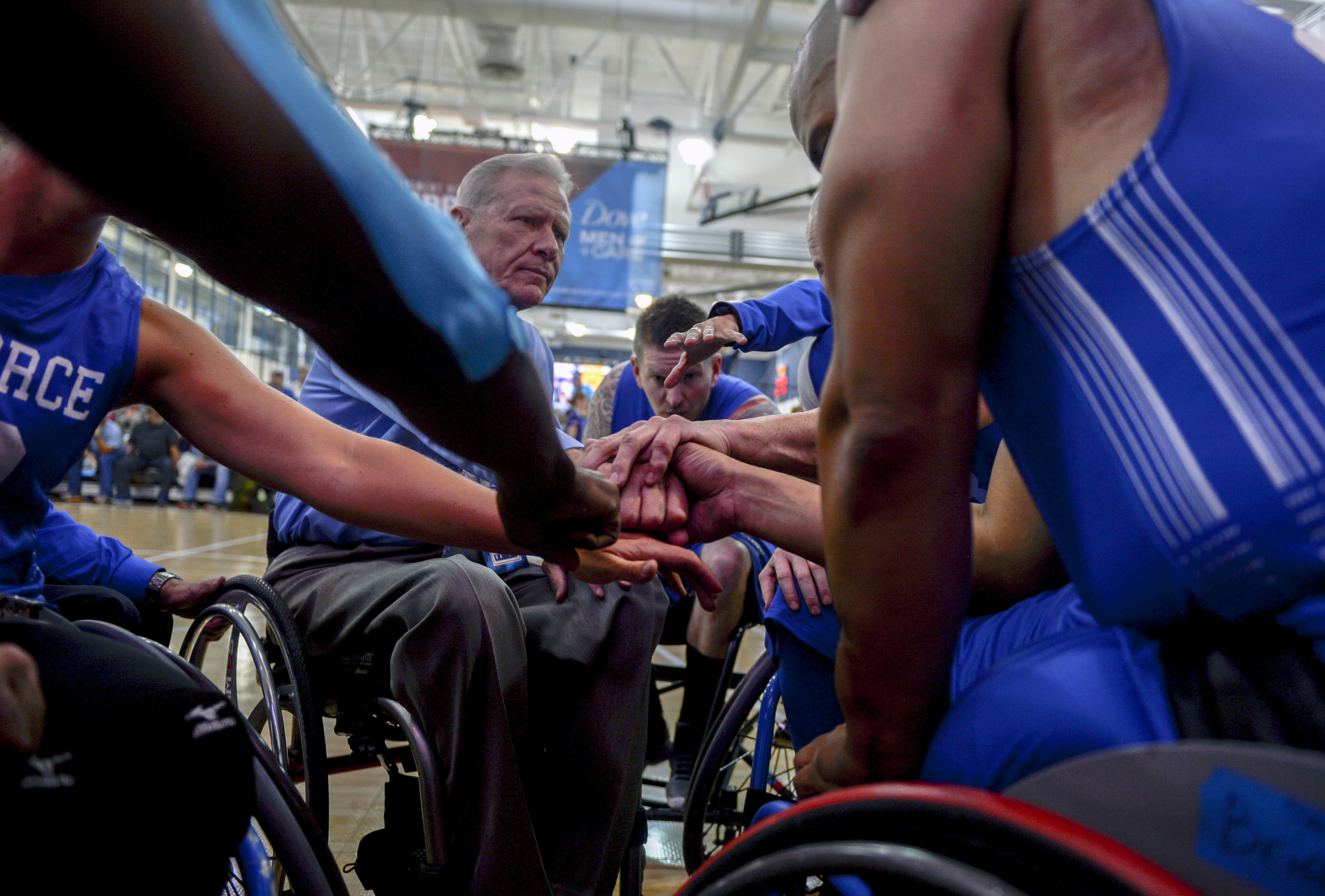A group of athletes in wheelchairs.